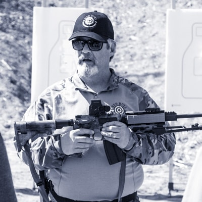 Basic Rifle Classes at Red Bull Firearms Training - Instructor holding a rifle and explaining to students