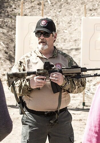Firearms Instructor explaining rifle to class at Basic Rifle
