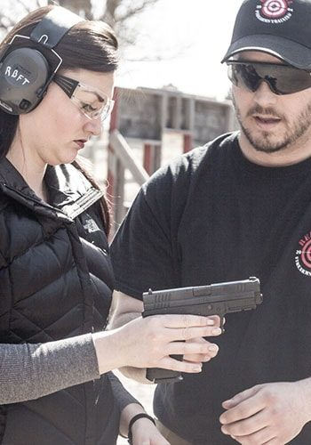 Instructor with student at Introduction to Firearms Classes