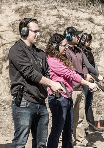 MN Permit to Carry Class - line of students at shooting range